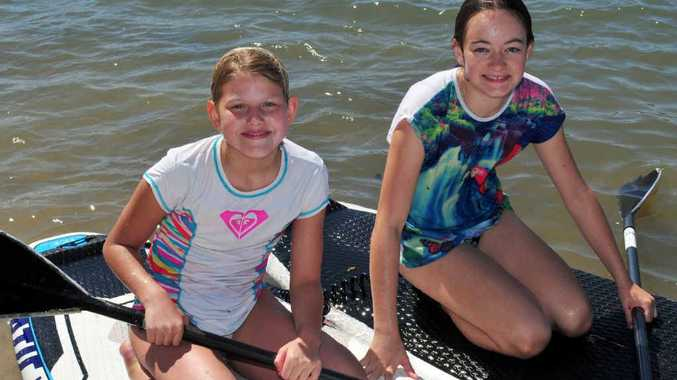 READY TO PADDLE: Visitors Anna Henkenhaf and Madeleine Cleland enjoy the Noosa River.