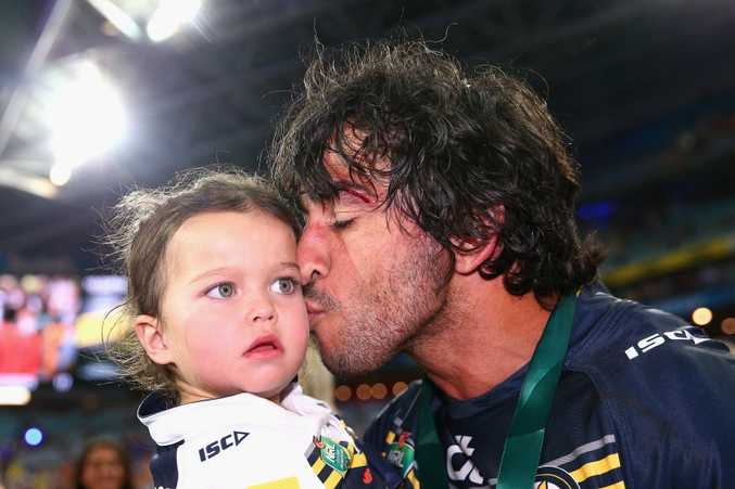 Victorious North Queensland Cowboys co-captain Johnathan Thurston with daughter Frankie.