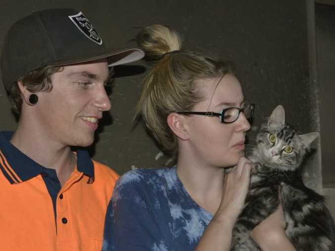 Chester the cat woke Charlie Gordon and Abbie Kark before a fire in their garage could spread into the unit.
