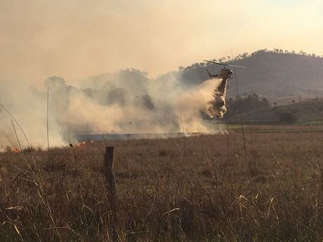Water-bombing aircraft douse a rapidly moving bushfire at West Haldon and Hirstglen. Photo Frances Whitsenhuysen / Gatton Star