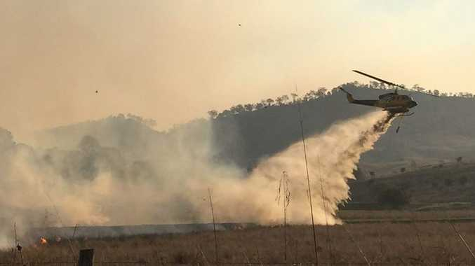 Water-bombing aircraft douse a rapidly moving bushfire at West Haldon and Hirstglen. Photo Francis Witsenhuysen / Gatton Star