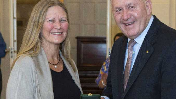 South Golden beach nurse Libby Bowell receives her award from Governor General Sir Peter Cosgrove.