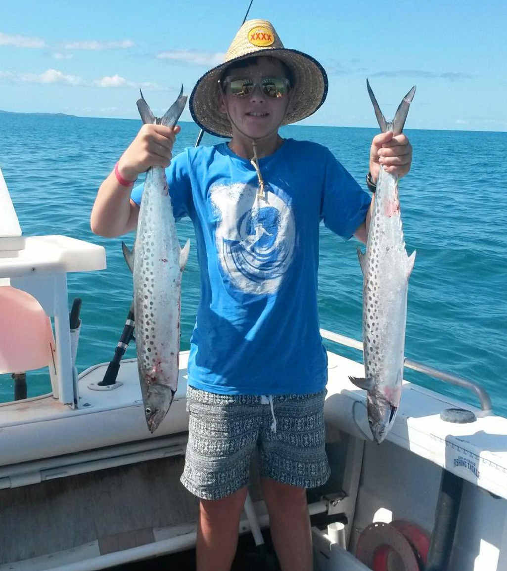 Jesse Fowler with a couple of the spotty mackerel he caught.