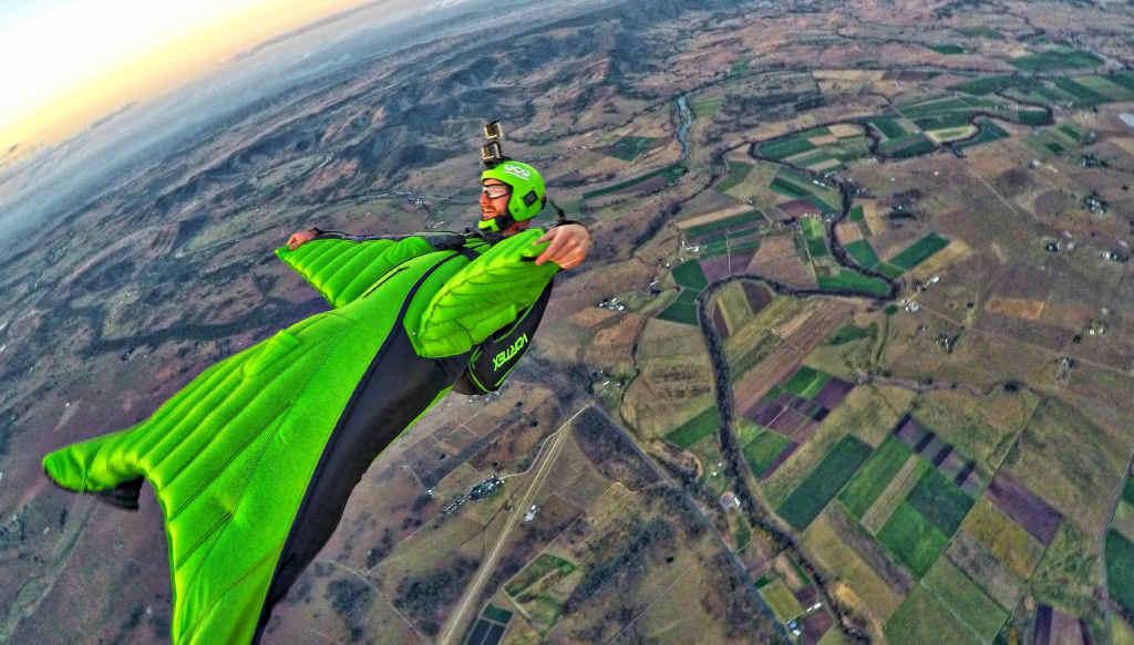 CRUISING ALTITUDE: Wingsuit pilot Chris Byrnes enjoys a sunset glide over Toogoolawah.