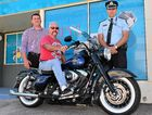 GOOD CAUSE: Tony Pignata, Pat Quinn and Inspector Jason Overland with the restored motorcycle that will be raffled to raise funds for injured Senior Constable Len Elliott.