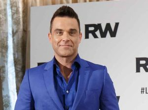 Robbie Williams breaks down during performance