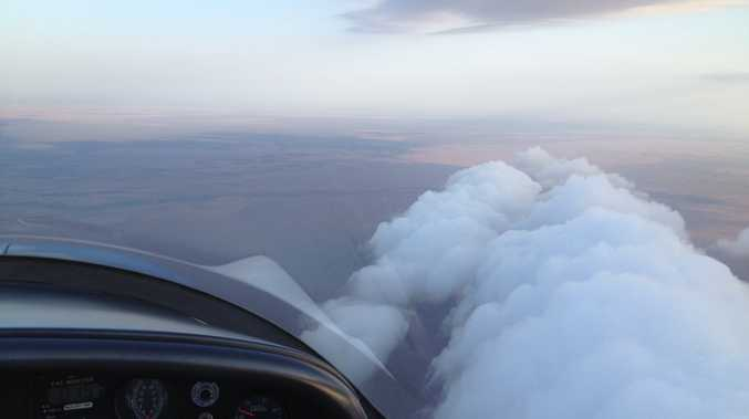 It's like sufing, but in an aircraft: Tyagarah-based glider pilots Rick Bowie and Adrian Black flew up to the Gulf of Carpentaria to ride a roll cloud.