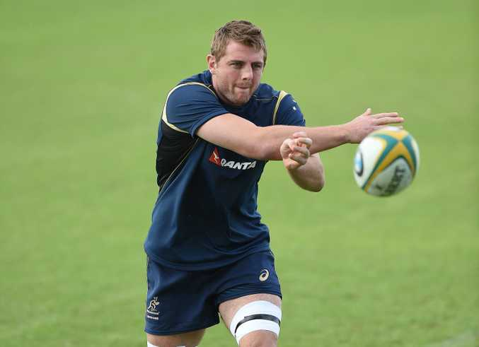 Dean Mumm passes the ball during the Australian Wallabies team training session.