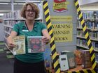 CENSORED: Hervey Bay Library community librarian holds up two books banned in the past. Photo Hannah Baker / Fraser Coast Chronicle