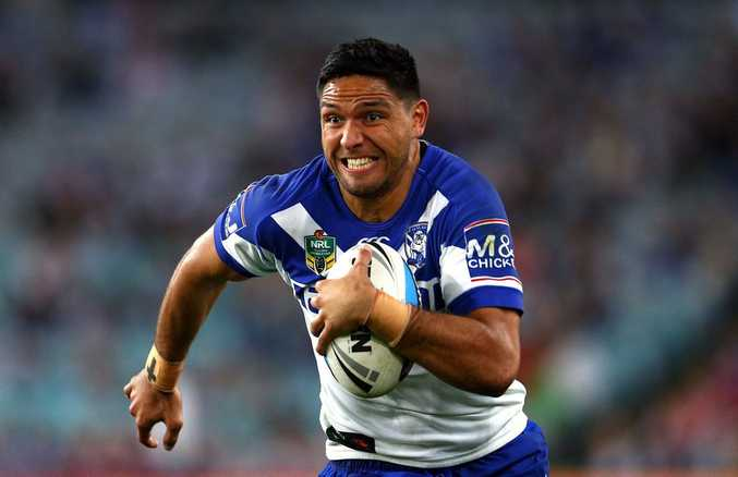 SYDNEY, AUSTRALIA - SEPTEMBER 12: Curtis Rona of the Bulldogs makes a break during the NRL Elimination Final match between the Canterbury Bulldogs and the St George Illawarra Dragons at ANZ Stadium on September 12, 2015 in Sydney, Australia. (Photo by Renee McKay/Getty Images)