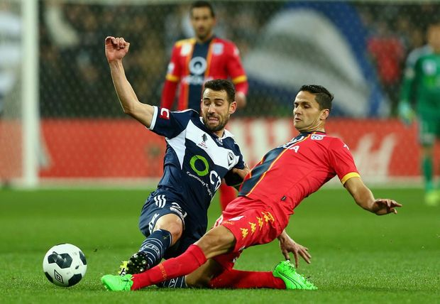 MELBOURNE, AUSTRALIA - SEPTEMBER 22: Carl Valeri of Victory and Osama Malik of Adelaide contest the ball during the FFA Cup Quarter Final match between the Melbourne Victory and Adelaide United at AAMI Park on September 22, 2015 in Melbourne, Australia. (Photo by Robert Prezioso/Getty Images)