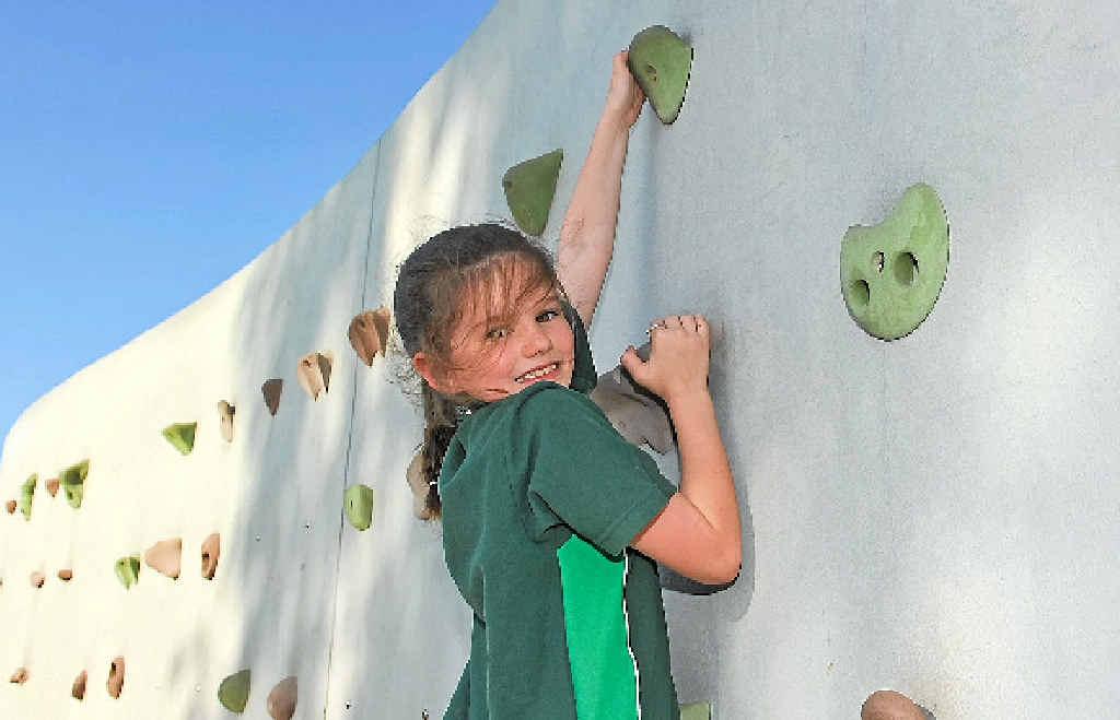 Ella Kershaw, 8, at the Gladstone rock climbing wall.