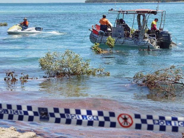 BIG JOB: Clayton's Towing crews attempting the salvage operation at Inskip Point, near Rainbow Beach, after a huge 'sinkhole' opened up and swallowed a car and caravan at the popular camping spot on Saturday, September 26.
