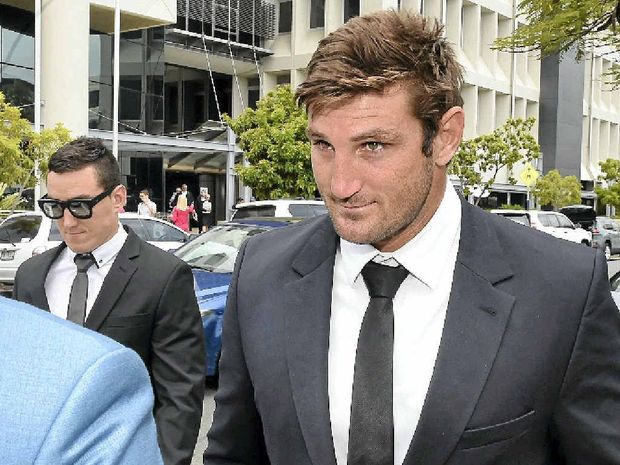 TRYING TIMES: Former Gold Coast Titan Dave Taylor leaves the Southport Magistrates Court yesterday after being committed to stand trial.