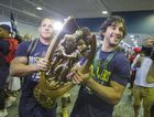 North Queensland Cowboys co-captain Matthew Scott and Johnathan Thurston hold the grand final trophy at Townsville Airport, Monday, Oct. 5, 2015. The Cowboys beat the Brisbane Broncos in the NRL Grand Final.