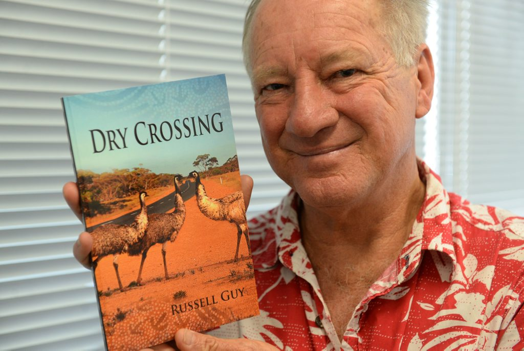 CONTEMPORARY FICTION: Agnes Water author Russell Guy with his novel Dry Crossing. Photo: Mike Knott / NewsMail