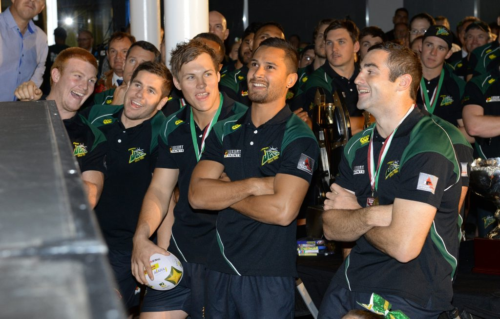 The Ipswich Jets were honoured with a parade in the Ipswich Mall after their stellar 2015 season on Thursday. A few of the players enhoyed watching a review of the season on the big screen. Photo: Rob Williams / The Queensland Times