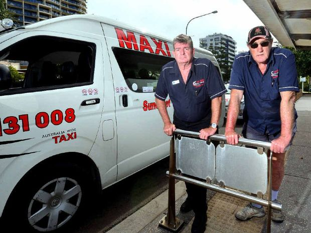 PLEA FOR ANSWERS: Taxi drivers Clark Chappel and Barry Stumbles are not happy about the introduction of Uber.