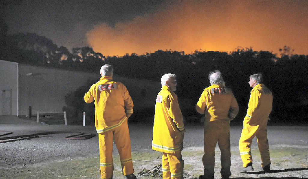 HEATING UP: CFA firefighters take a short break and watch a spot fire near Benloch, Victoria, this week.