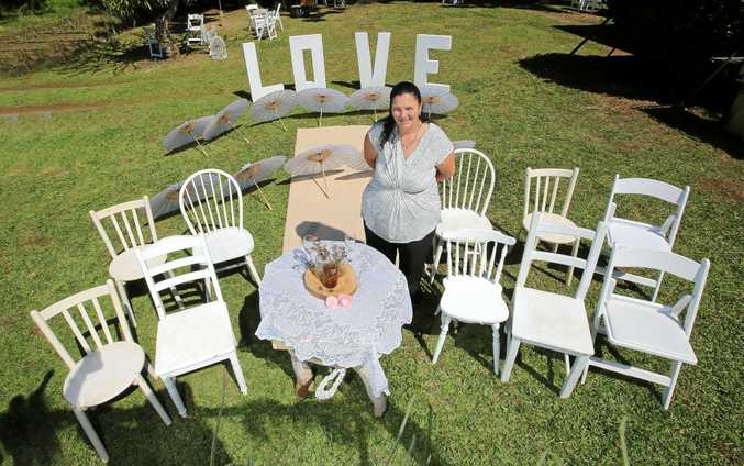 Tweed Heads Wedding Hire's Natasha Shearer-Lambert with a selection of wedding hire products. Photo: Scott Powick Daily News