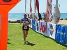 Competitors cross the Adventurethon finish line at Jetty Foreshore.