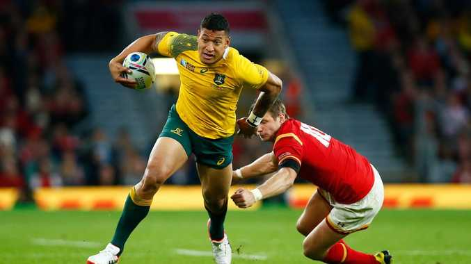 Israel Folau in action in Australia's group win over Wales.
