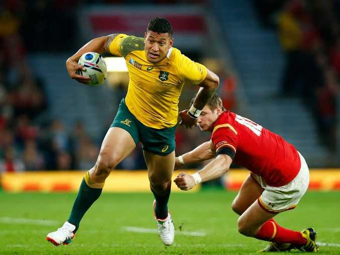 LONDON, ENGLAND - OCTOBER 10: Israel Folau of Australia evades a tackle by Dan Biggar of Wales during the 2015 Rugby World Cup Pool A match between Australia and Wales at Twickenham Stadium on October 10, 2015 in London, United Kingdom. (Photo by Mike Hewitt/Getty Images)
