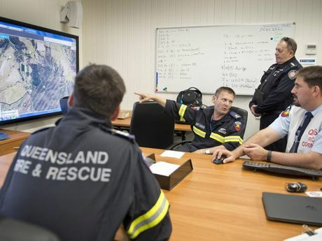 ( From left ) Christopher Thompson, Brett McIlwaine Peter Bradow and Lawrence Laing. QFES/QFRS regional operations co-ordination centre.