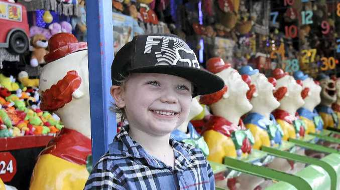 WINNERS ARE GRINNERS: Cooper Hyde, 4, is all smiles after winning a prize on the clowns at the Kyogle Show.