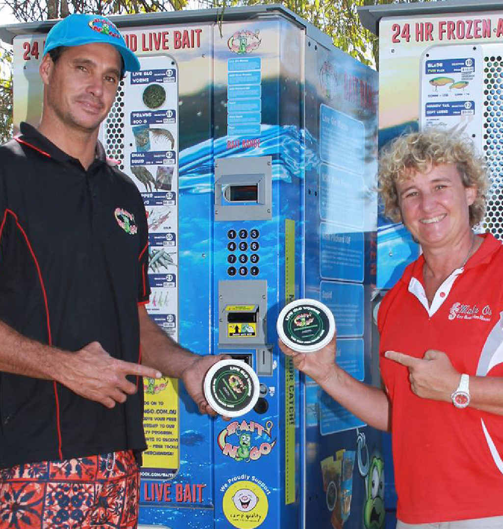 HANDY: Simon Knox of Bait N Go shows one of his vending machine to Kirsty Patten of Malu Os Eco Boat Hire.