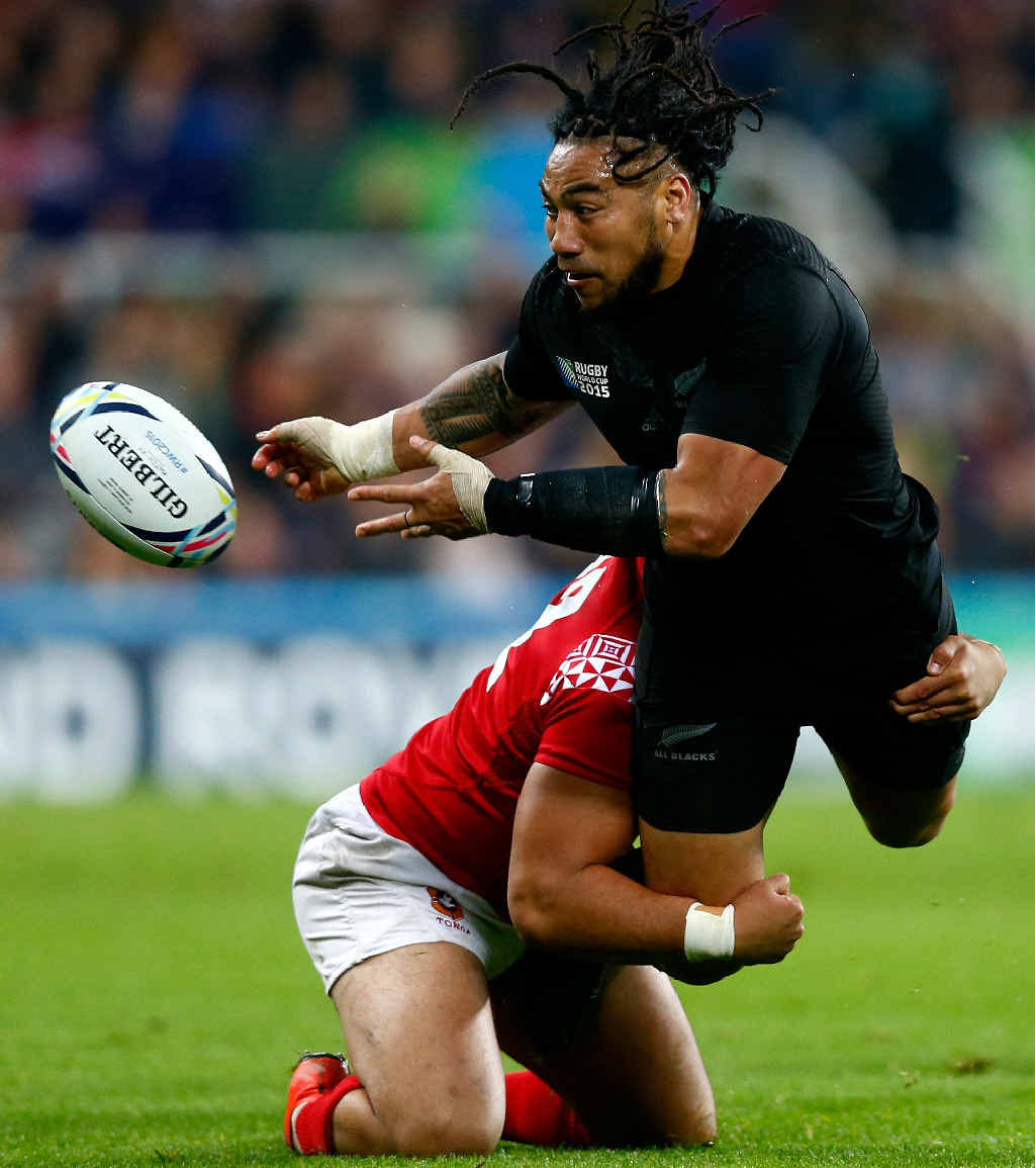CALM UNDER PRESSURE: New Zealand's Ma'a Nonu manages to get the pass away as his legs are taken from under in the clash against Tonga at St James' Park, Newcastle upon Tyne.