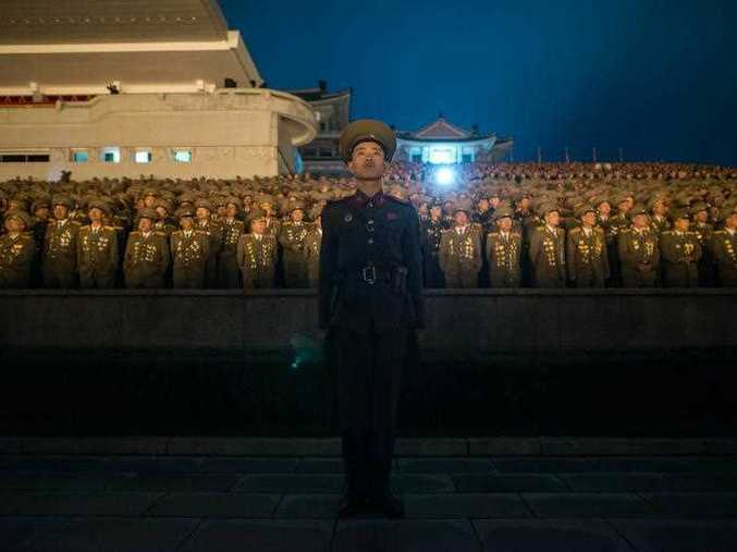 A North Korean soldier stands before spectators during a torch-light performance in Pyongyang on October 10, 2015. North Korea was marking the 70th anniversary of its ruling Workers' Party.