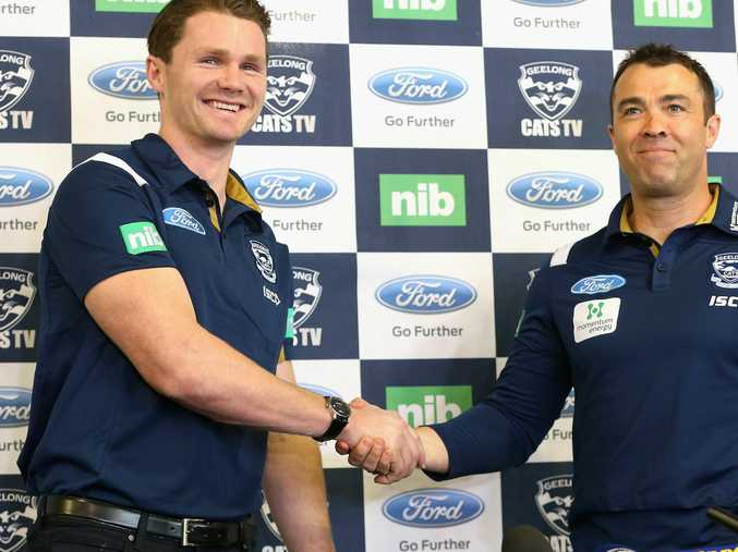 Patrick Dangerfield shakes hands with Geelong coach Chris Scott after his trade to the Cats.