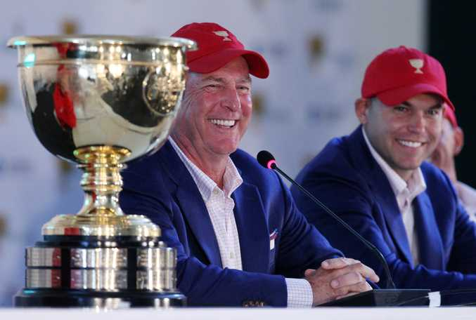 US team captain Jay Haas, left and his son Bill address a press conference after they defeated the International team 15 1/2 to 14 1/2 to retain the Presidents Cup at the Jack Nicklaus Golf Club Korea, in Incheon, South Korea.