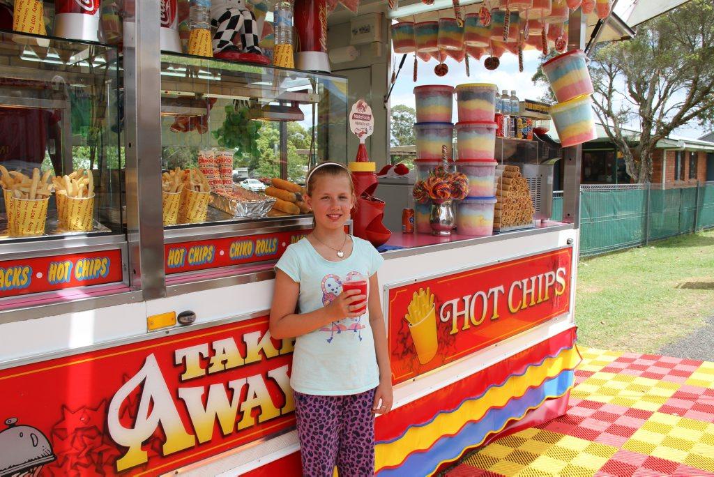 Lilly Feakes, 11, of Kyogle, enjoying a raspberry slushie at the 2015 Kyogle Show.
