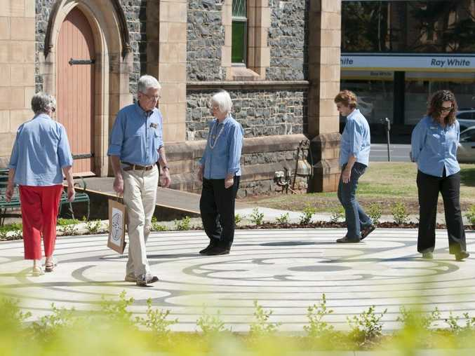 Walking the newly opened Toowoomba City Labyrinth are (from left) Shirley Thallan, John Power, Del Wagland, Yvonne McErlean and Joanne Bray of Toowoomba Visitor Information Centre on the grounds of St Luke's Church, Monday, October 12, 2015. Photo Kevin Farmer / The Chronicle