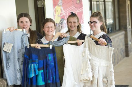 Fairholme College students (from left) Emily Molloy, Jordan Dohle, Maree Williams and Bridgette Ostwald show off sustainable designs made in collaboration with slow fashion advocate Jane Millburn.