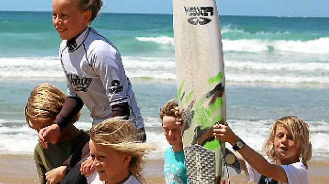 STOKED: Lennox Head surfer Nyxie Ryan is chaired up the beach after winning her age division at the Wahu Grom in Coffs Harbour.