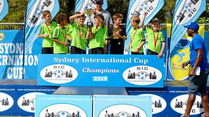 CHAMPS: NR Football Academy under-10s holding the Sydney International Cup aloft.