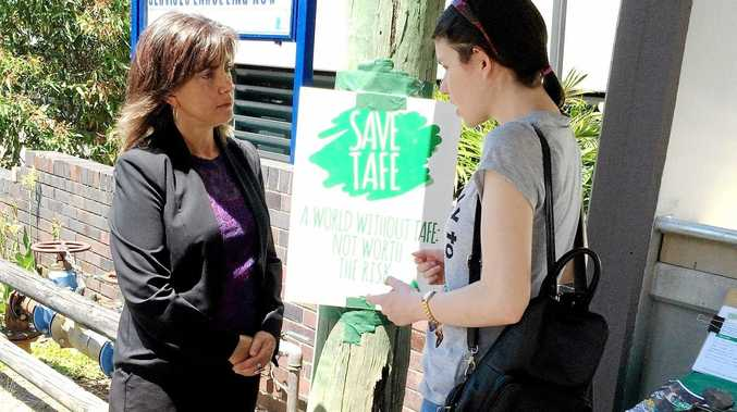CAMPAIGN MODE: Greens candidate for Richmond Dawn Walker speaks to a Community Services student outside Murwillumbah TAFE during the Hands Off TAFE day of action.