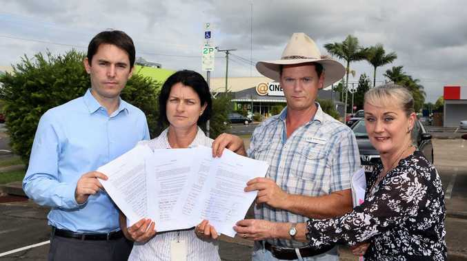 Councillor George Seymour (left), Councillor James Hansen and Ergon employees, Maria Fuchs and Denise Young holding a petition against the new timed parking in Maryborough car parks. Photo: Brendan Bufi / Fraser Coast Chronicle
