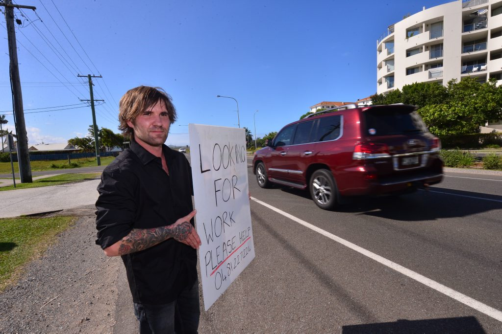 Daniel is looking for a job and was seen holding this sign in Marcoola. Photo: John McCutcheon / Sunshine Coast Daily