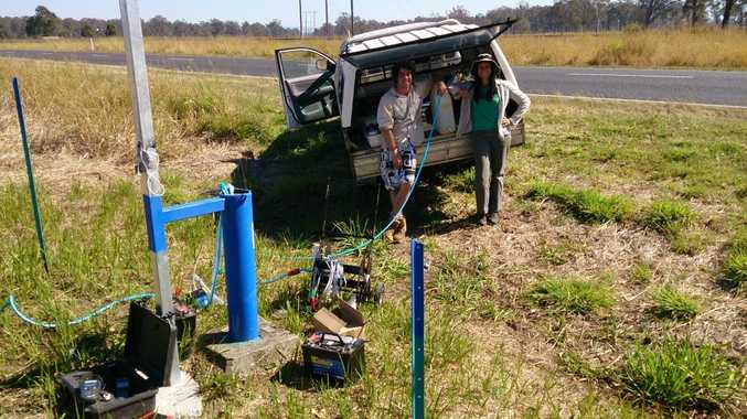 PhD candidate Marnie Atkins (right) testing groundwater bores near Casino in September 2013 with environmental science (Honours) graduate Ben Stewart. Photo: Southern Cross University