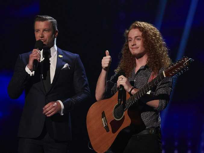 Jimmy Davis pictured with The X Factor host Luke Jacobz after his performance of The Killers song When You Were Young.