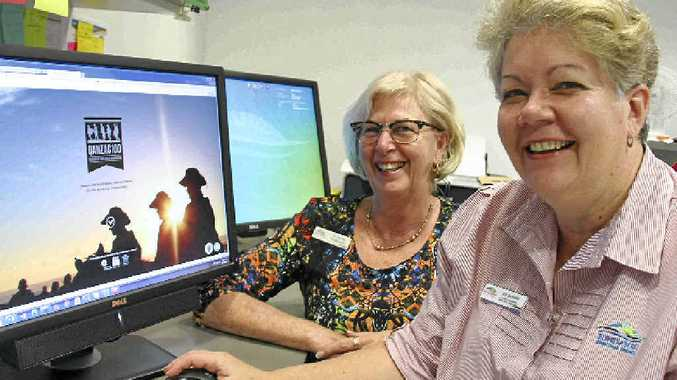 WAR STORIES: Councillor Lynne Forgan and Bundaberg librarian Sue Gammon look at the Q100 Anzac project.