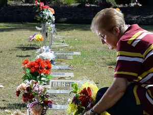 Mum heartbroken as flowers taken from babies' graves