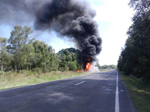 A caravan burns after a crash at Rileys Hill.