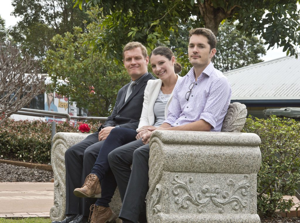 IN MEMORY: Roger and Jill Guard's children (from left) Paul Guard, Amanda Koopman and David Guard with the seat unveiled in Roger's memory at Toowoomba Hospital on Friday, July 24, 2015.