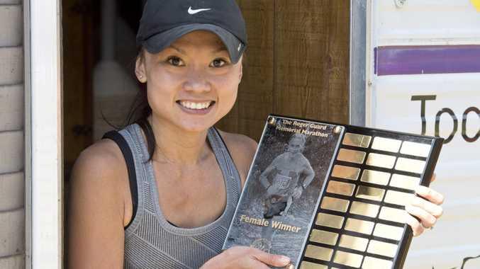 Roger Guard's niece Ashley Garrett won the women's title at this year's Toowoomba Road Runners Roger Guard Memorial Marathon.