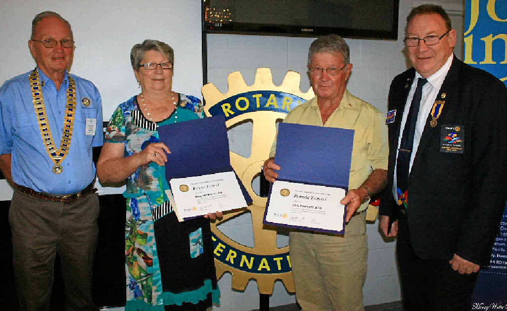 HONOURED: Rotary Club of Airlie Beach president Fred Dixon, Paul Harris Fellow recipients Helene and Ron Telford and district governor Mike Woods.